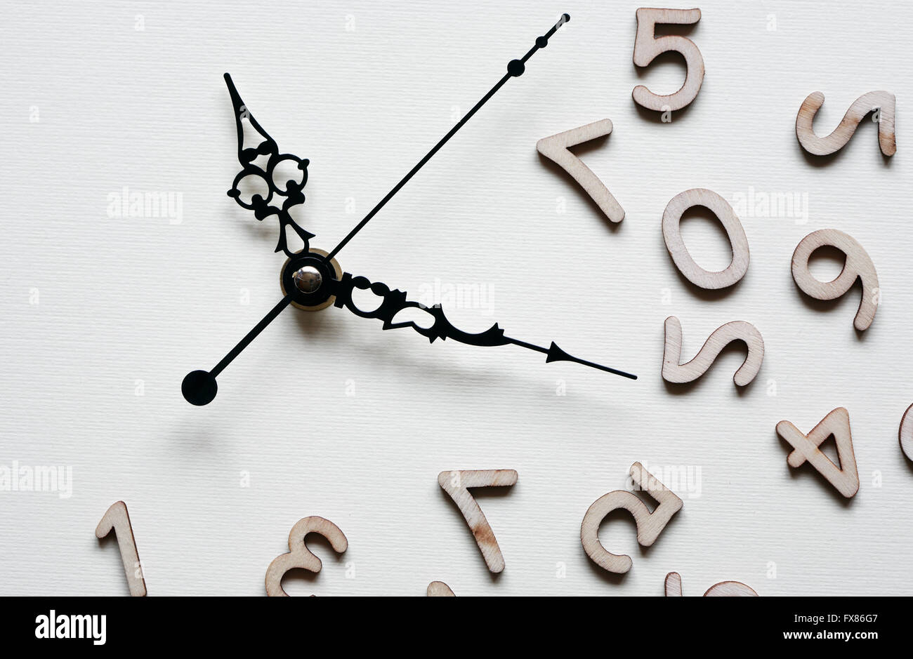 Time concept. Minute and second hands near set of wooden digits Stock Photo