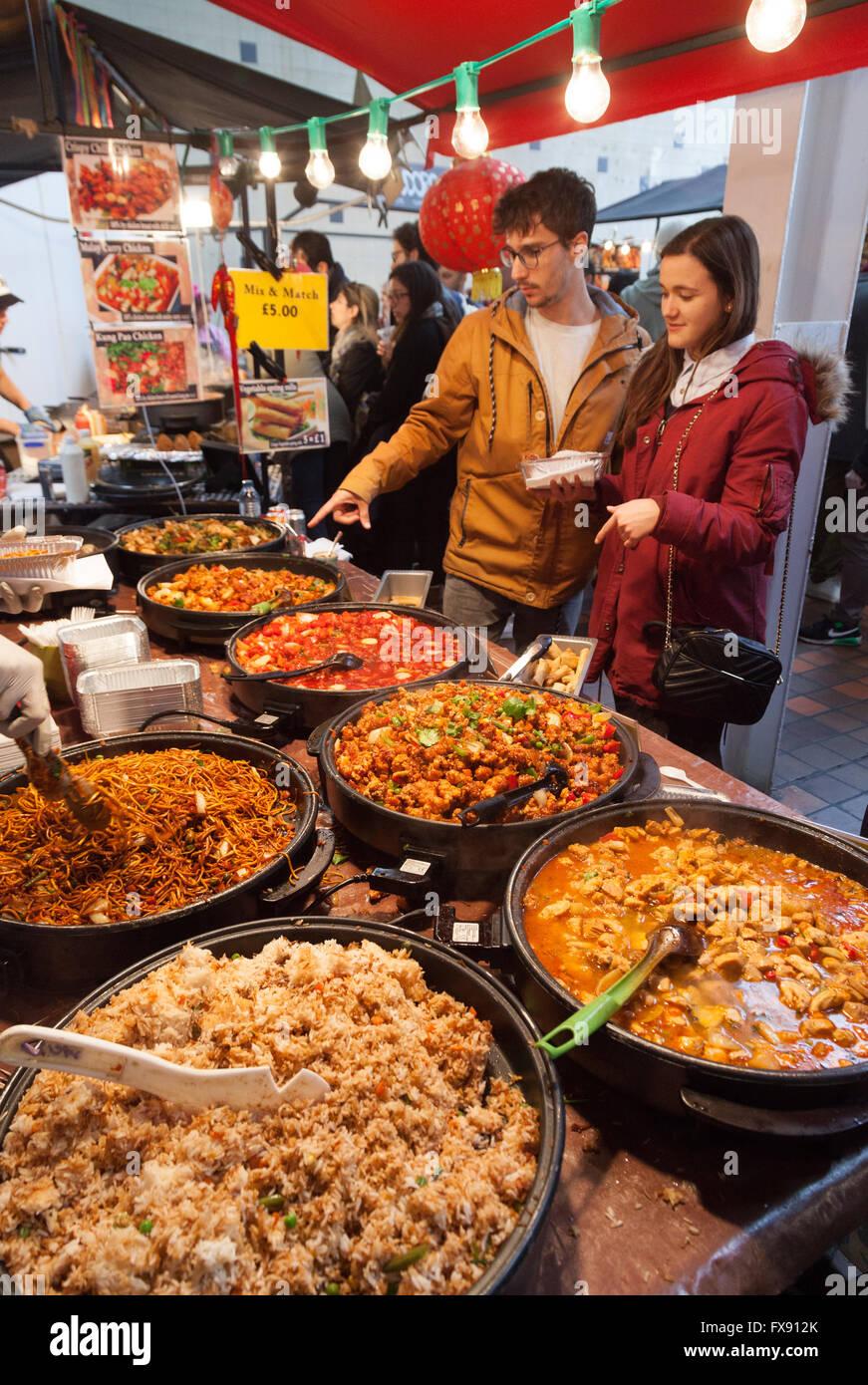 people-buying-food-at-a-chinese-street-food-stall-brick-lane-sunday-FX912K.jpg