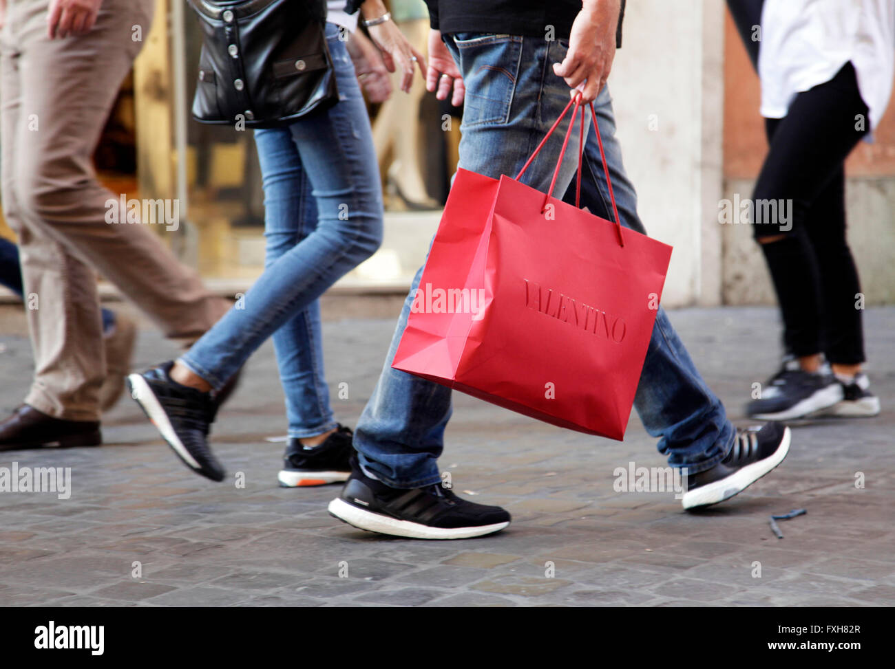 Man walks with his Valentino shopping bag in the street of Rome ... 7679225473f