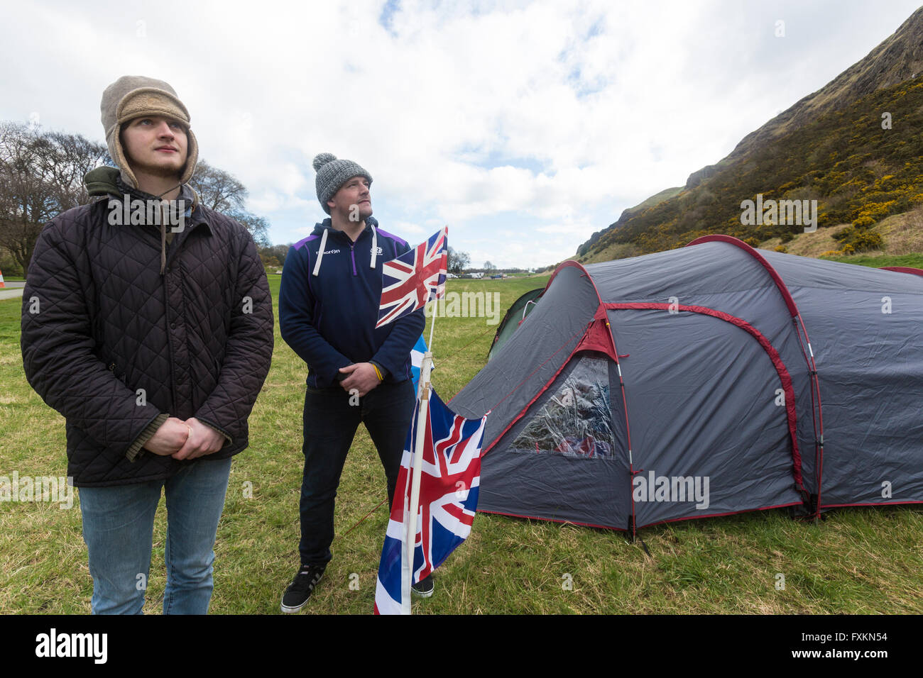 Holyrood Park, Edinburgh, Scotland. 16th April, 2016. Neil Tannahill and James Woodward have set up a rival camp - Stock Image