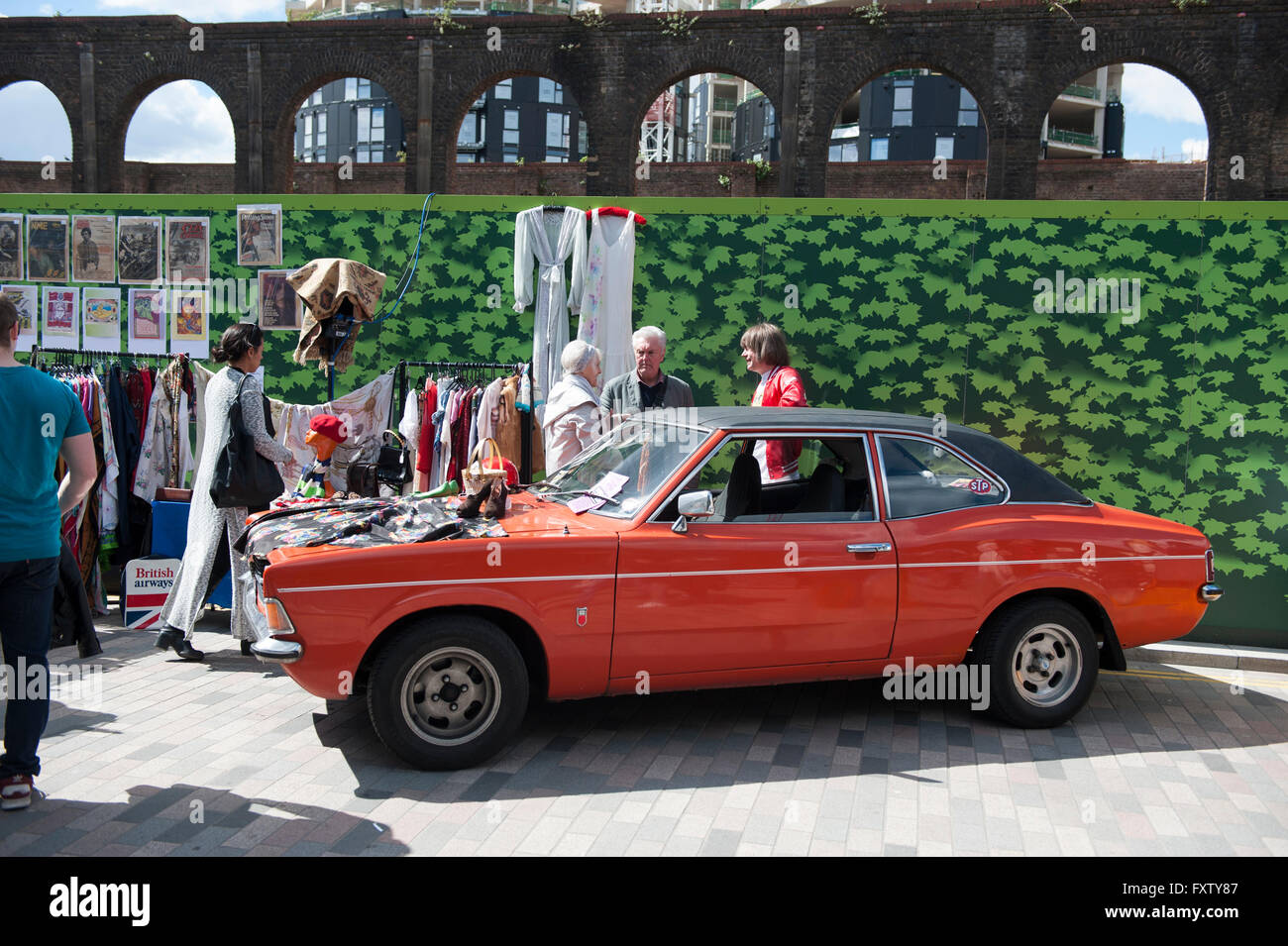An old vintage red car at the Classic car boot sale in Cubitt Square ...