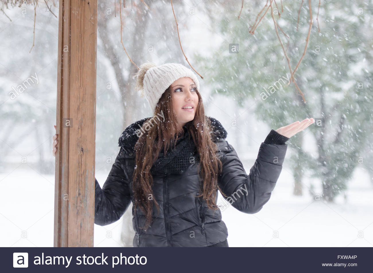 ca56a156ec Woman playing with the snow