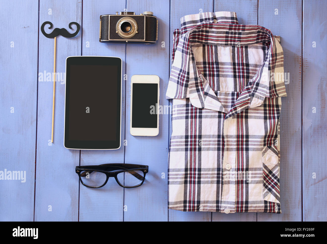top view image of hipster accessories and clothes a wooden background. vintage filtered and toned - Stock Image