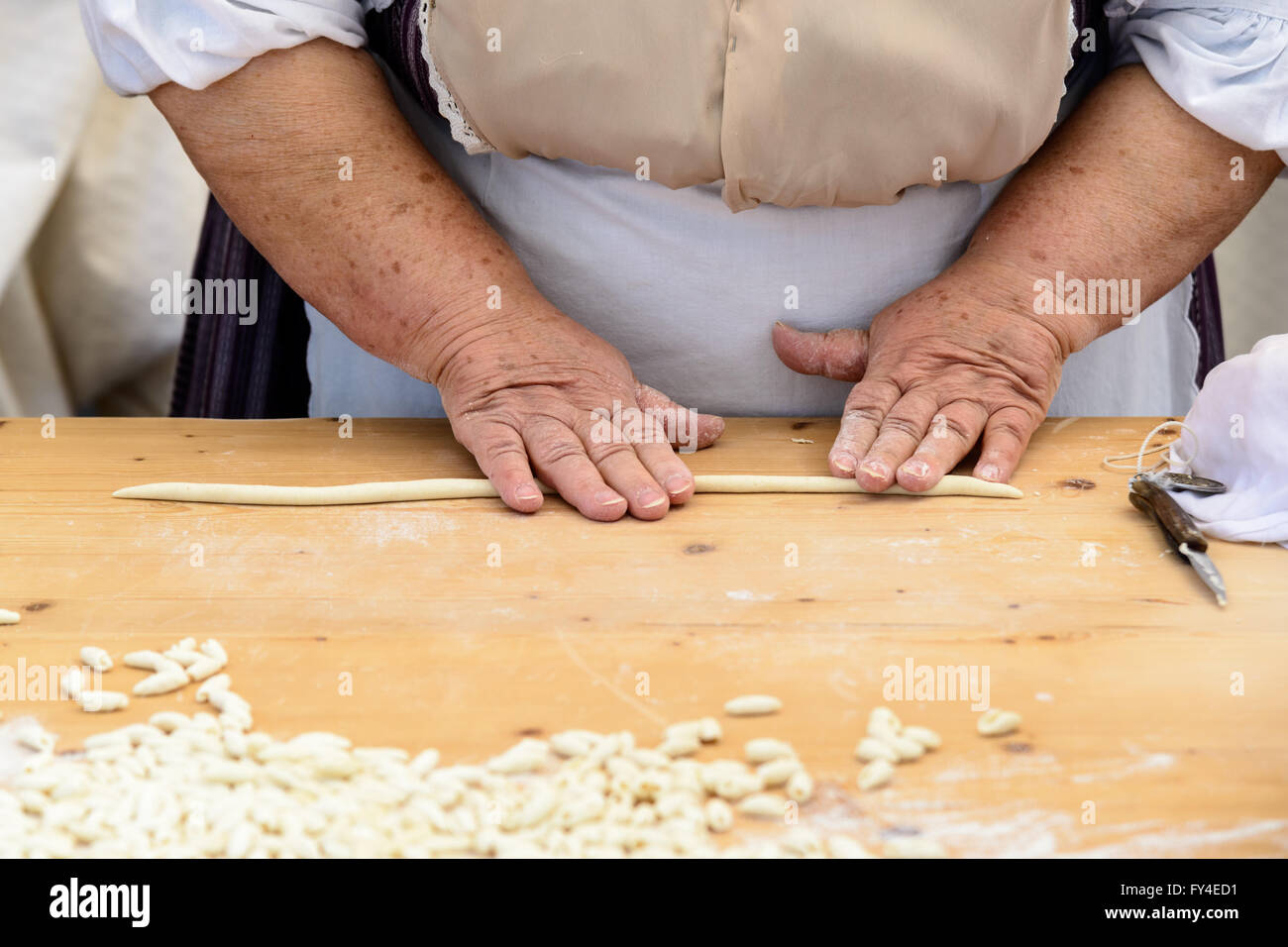 Gnocchi pasta of Sardinia, prepared by hand from old cook. Stock Photo