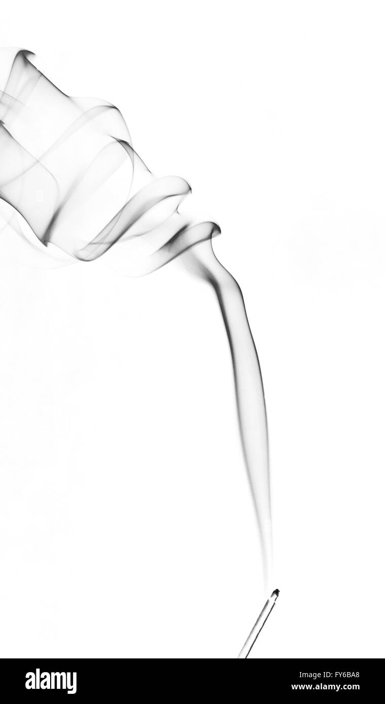 Mono steam smoky smoke pattern. The vapour from a burning incense stick against a white background. Stock Photo