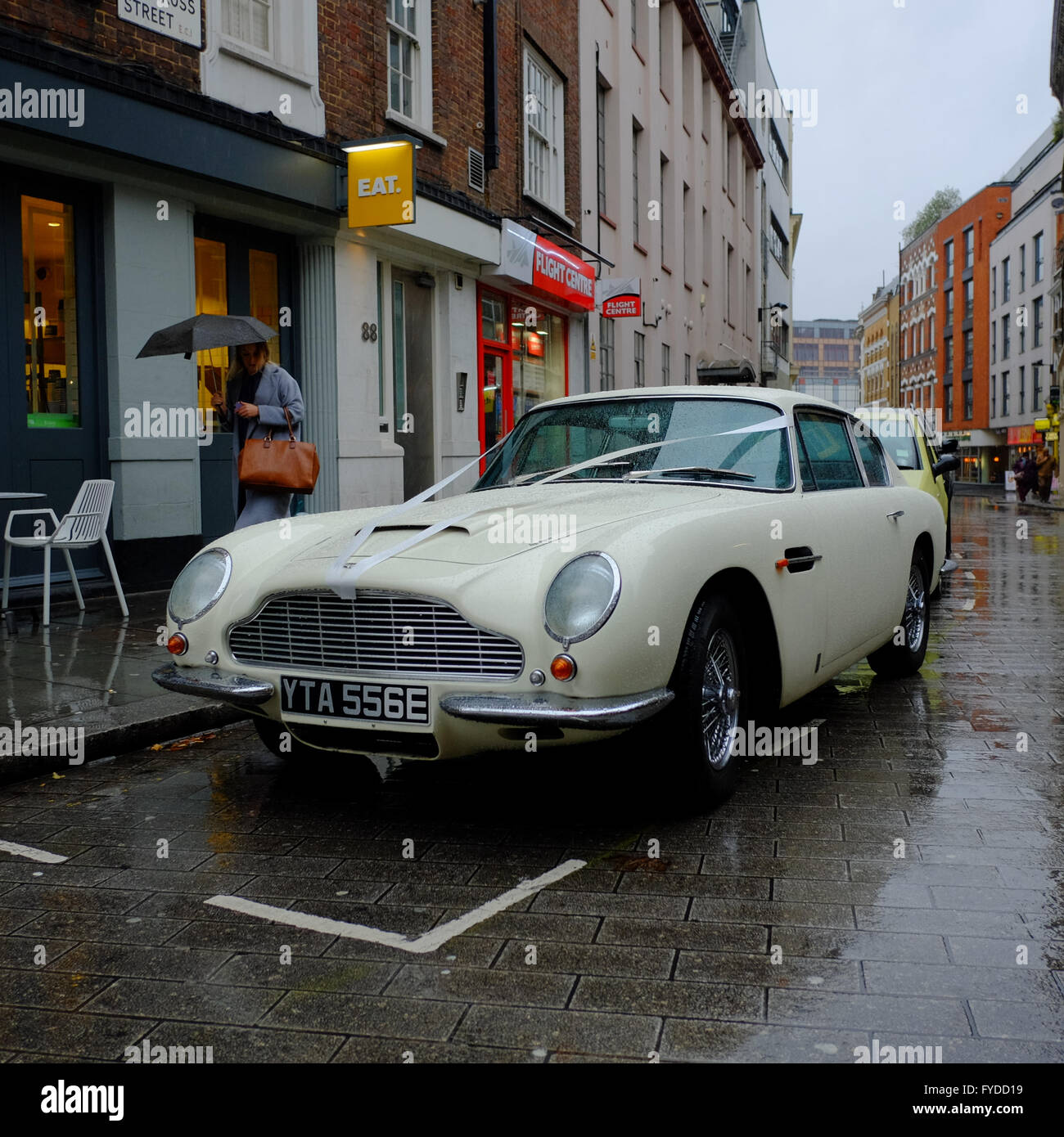 white aston martin db5 classic sports car decorated with wedding