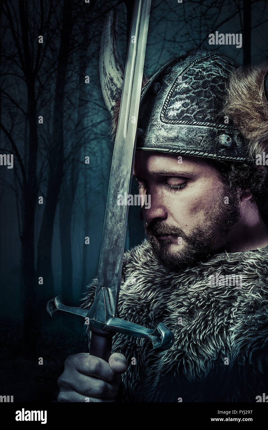 Peace, Viking warrior, male dressed in Barbarian style with sword, bearded - Stock Image
