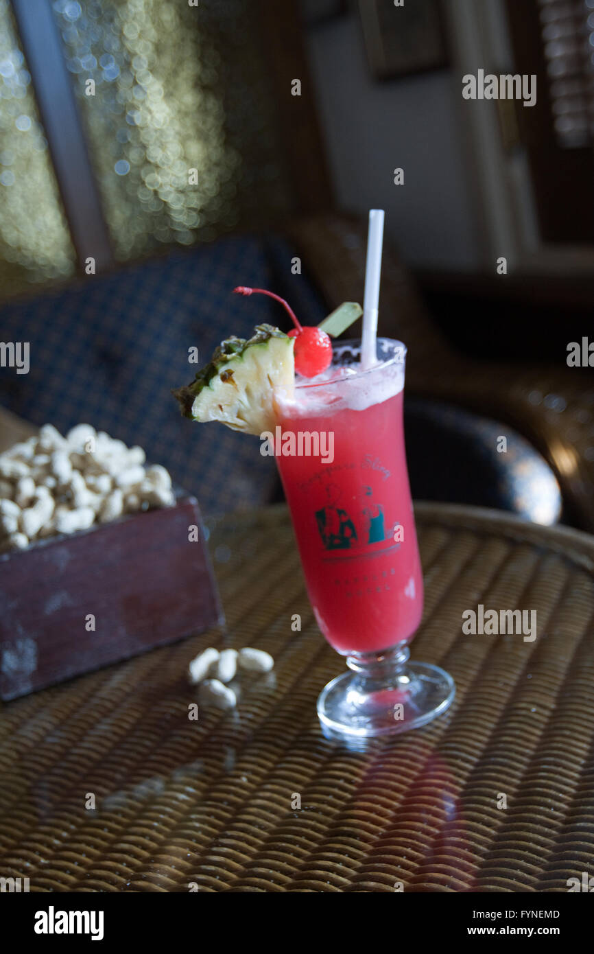 Singapore Sling cocktail served at the Long Bar Singapore Raffles Hotel Stock Photo
