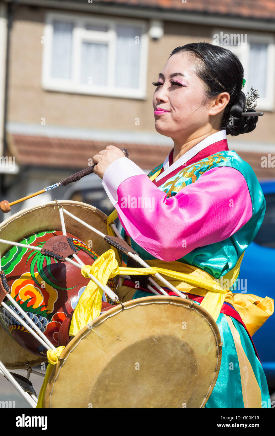 Musician with drum from South Korea in traditional costume. - Stock Image