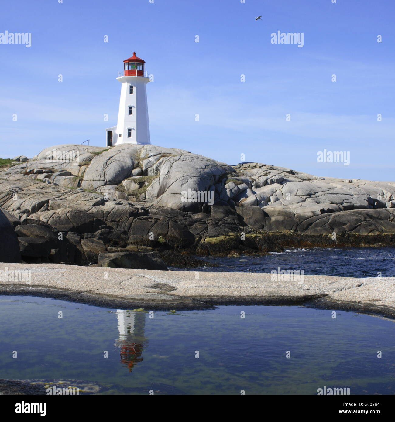 lighthouse at Peggy`s Cove, a Fishing Village, - Stock Image