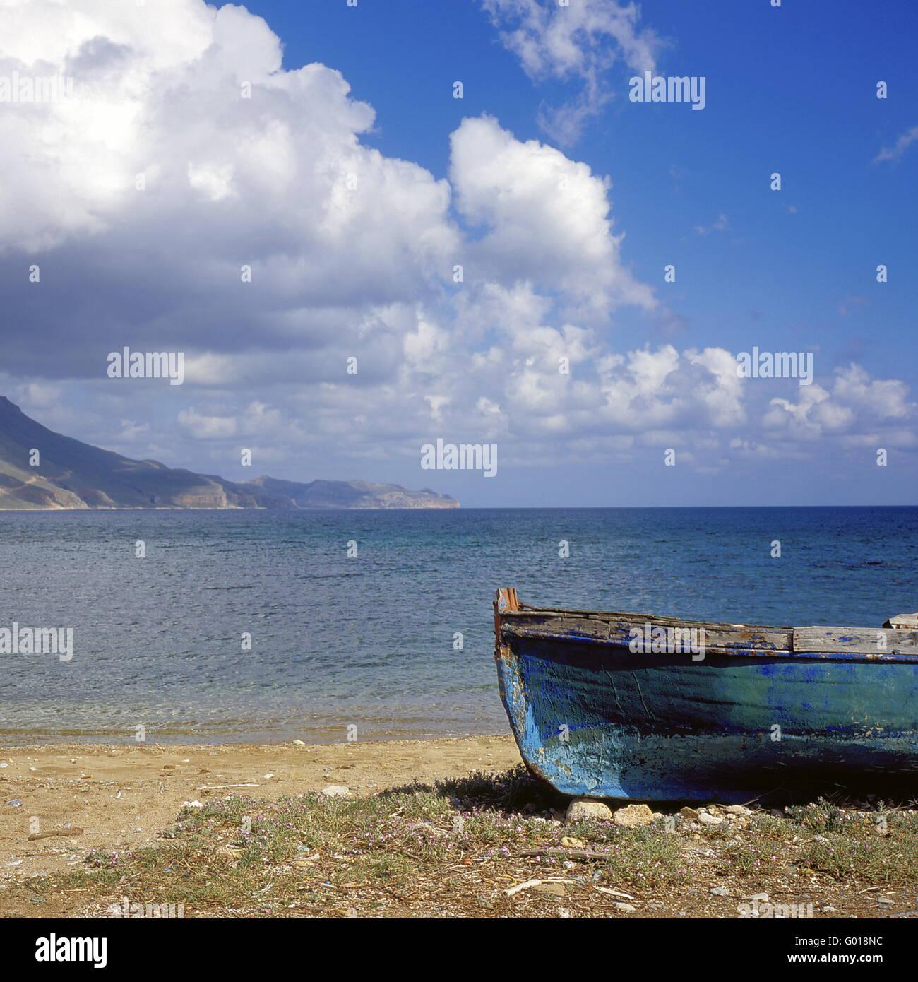 fishing boat at the beach o fCrete Island, Greece - Stock Image
