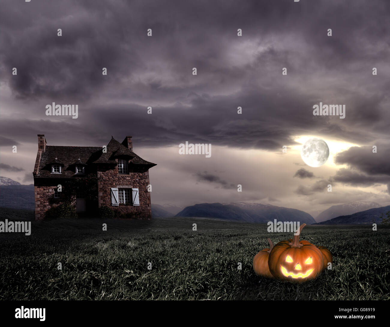 Apocalyptic Halloween scenery with old house and pumpkin - Stock Image