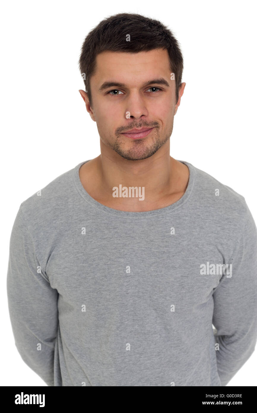 Portrait of a young man with a sly grin - Stock Image