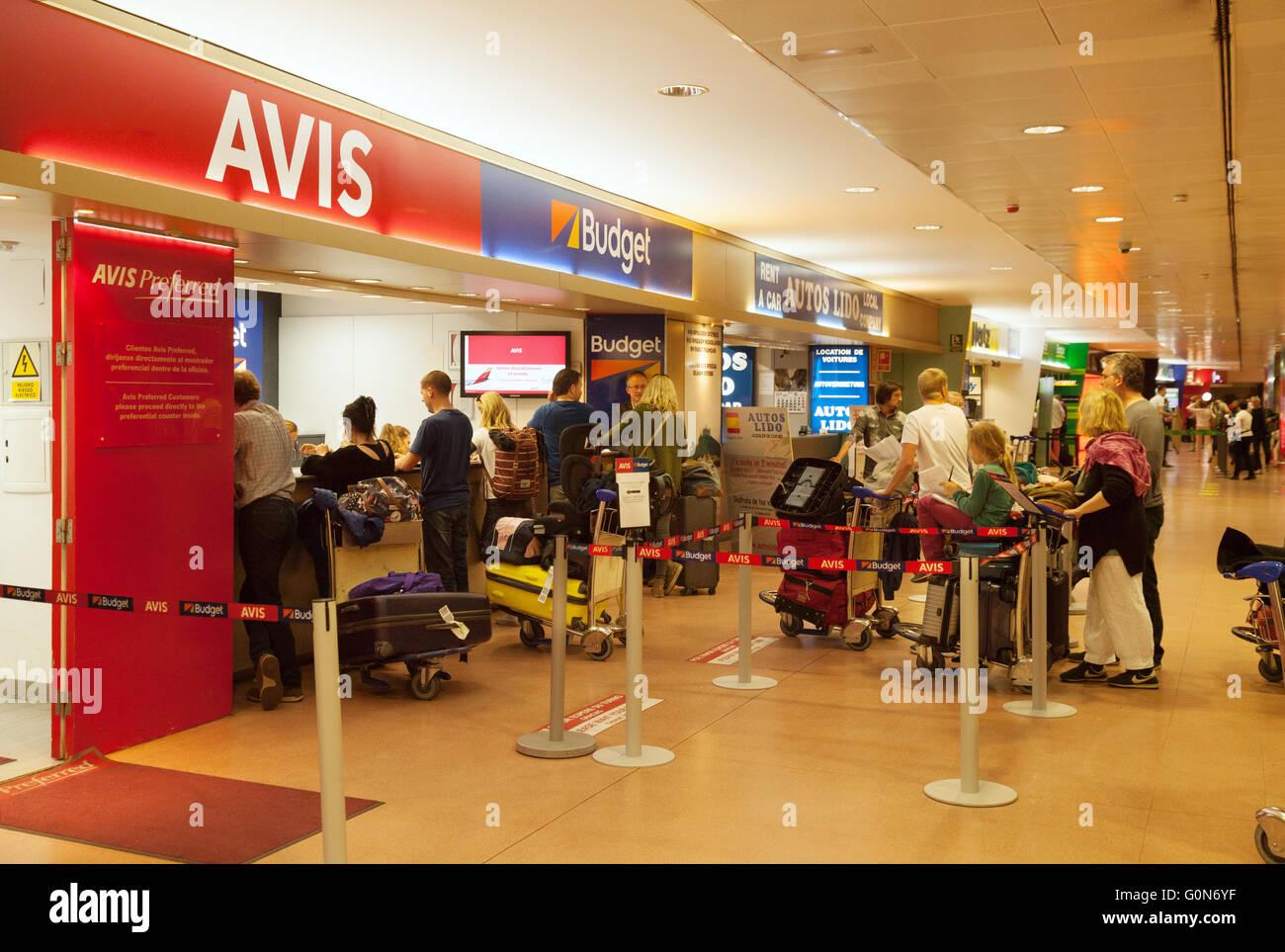 Holiday makers queue at car rental desks, Malaga airport, Costa del Sol, Spain, Europe Stock Photo
