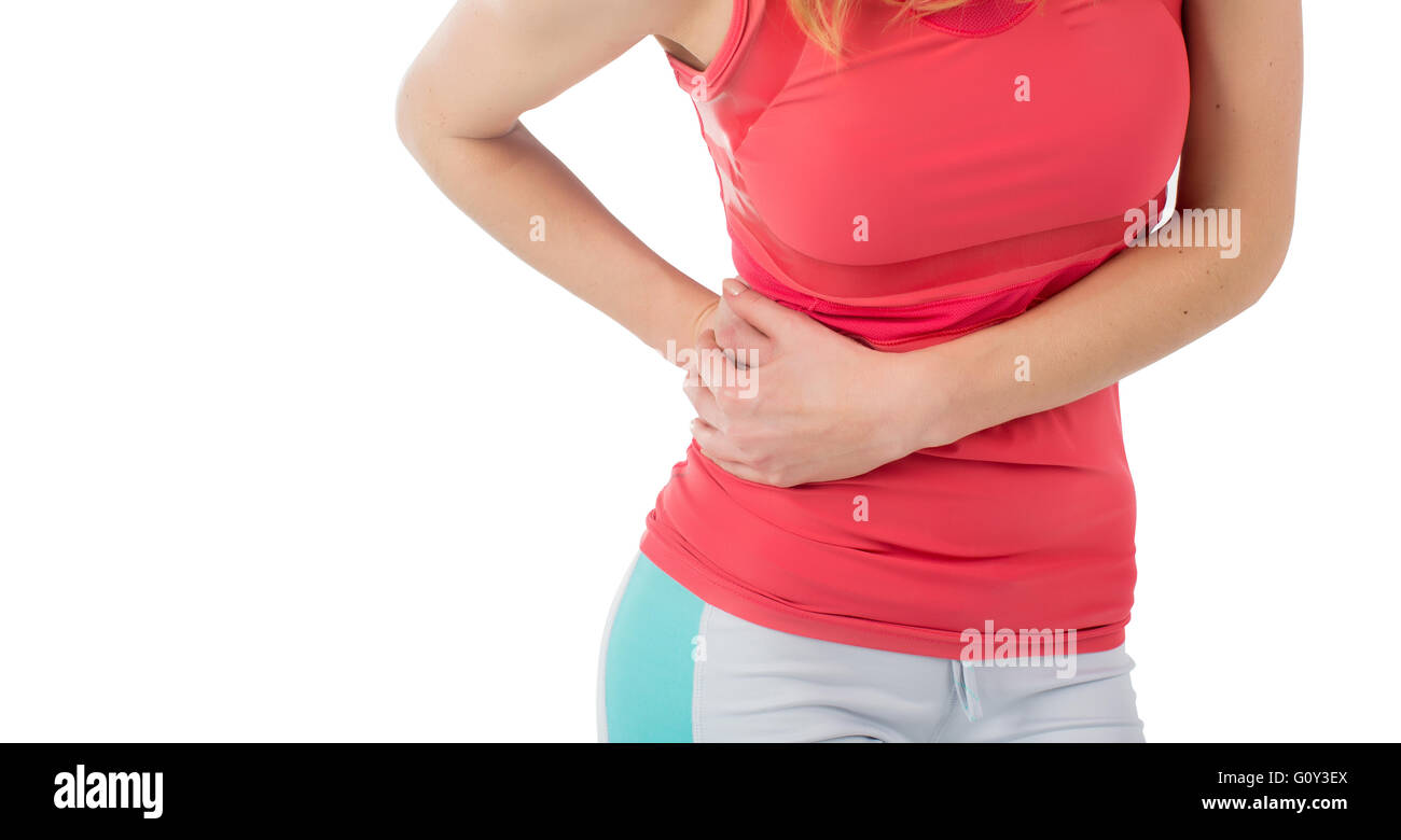 Woman athlete with side stitch cramp - Stock Image