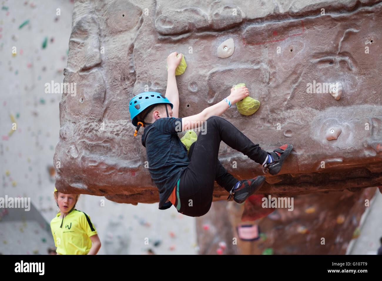 Climber bouldering at an indoor rock climbing centre in Ratho Edinburgh - Stock Image