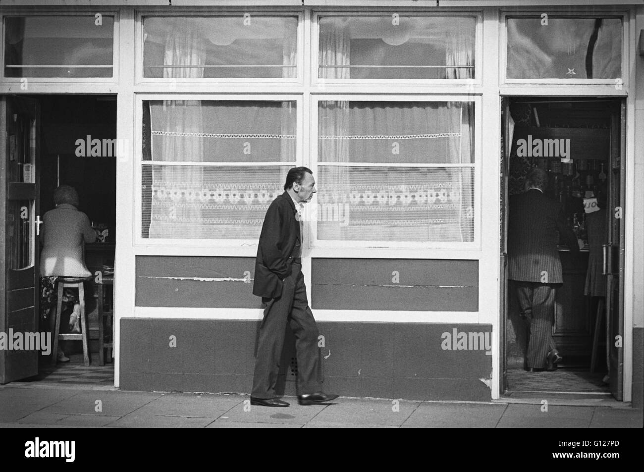 Archive image of a man walking between two entrances of a pub, Lambeth, London, England, 1979, alternative version Stock Photo