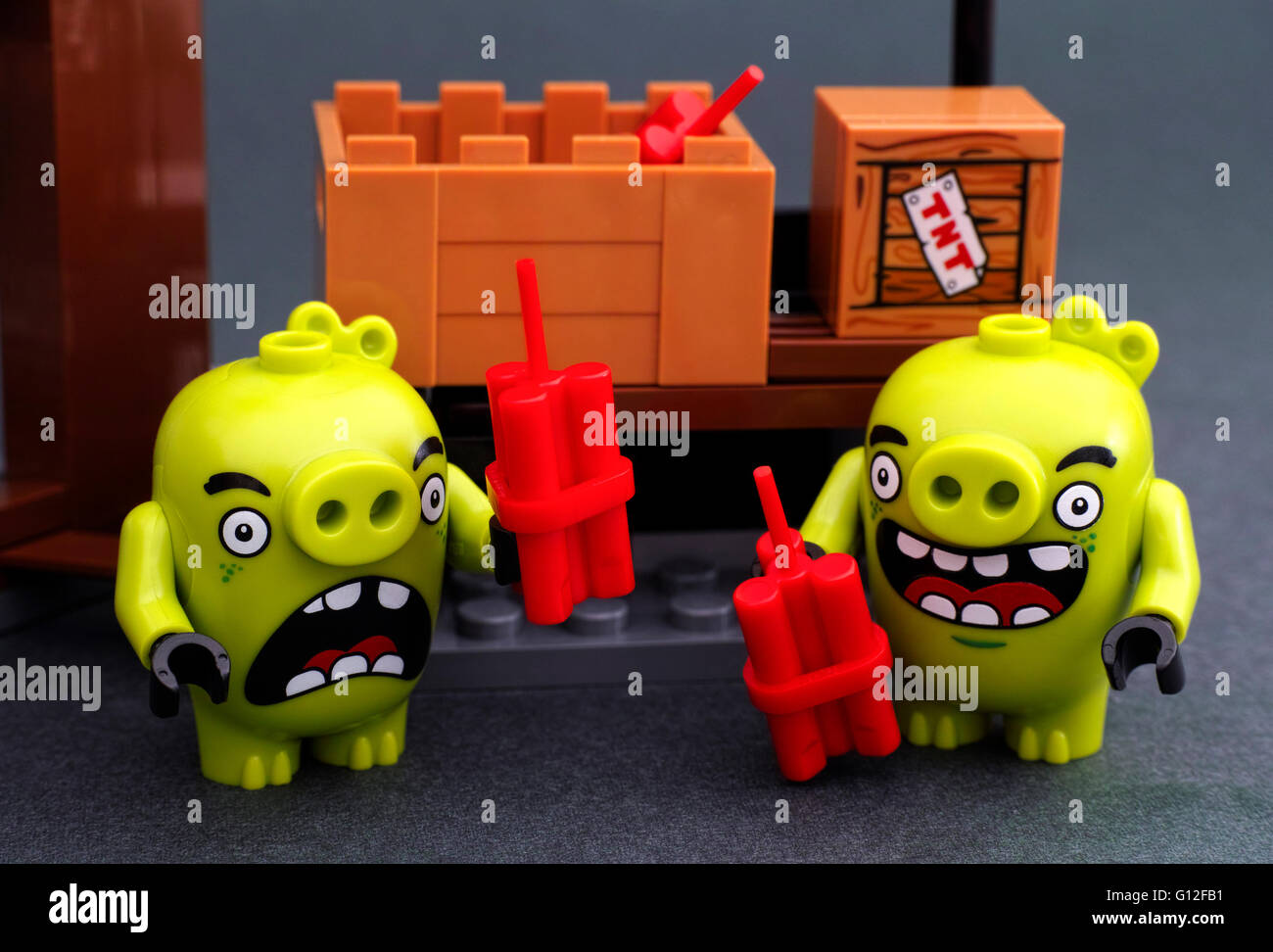 Tambov, Russian Federation - April 14, 2016 Lego Angry Birds. Two bad piggies with dynamite. Studio shot. - Stock Image