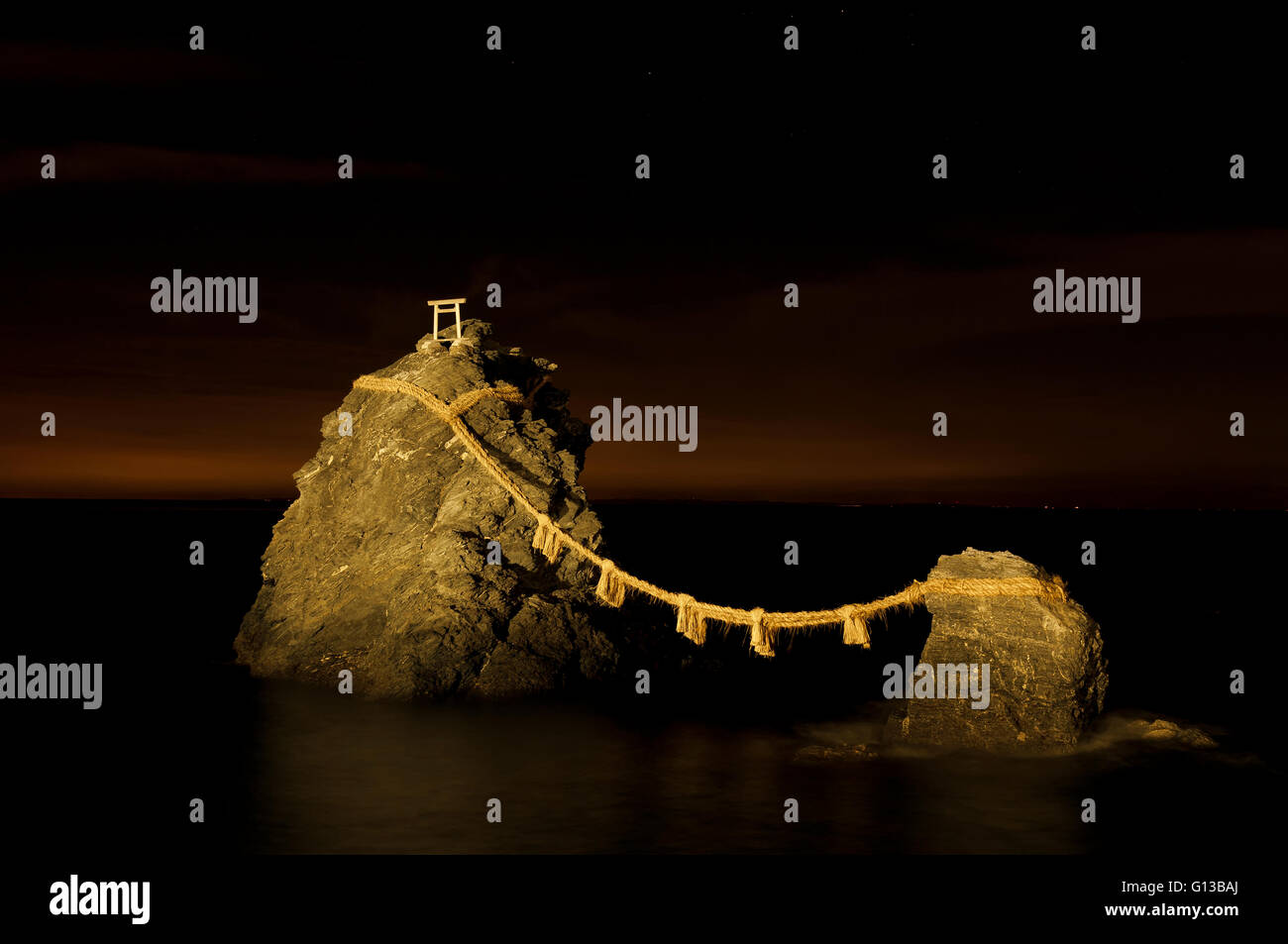 Meoto Iwa or the Loved one-and-loved one Rocks, are a couple of small rocky stacks in the sea off Futami, Mie, Japan - Stock Image