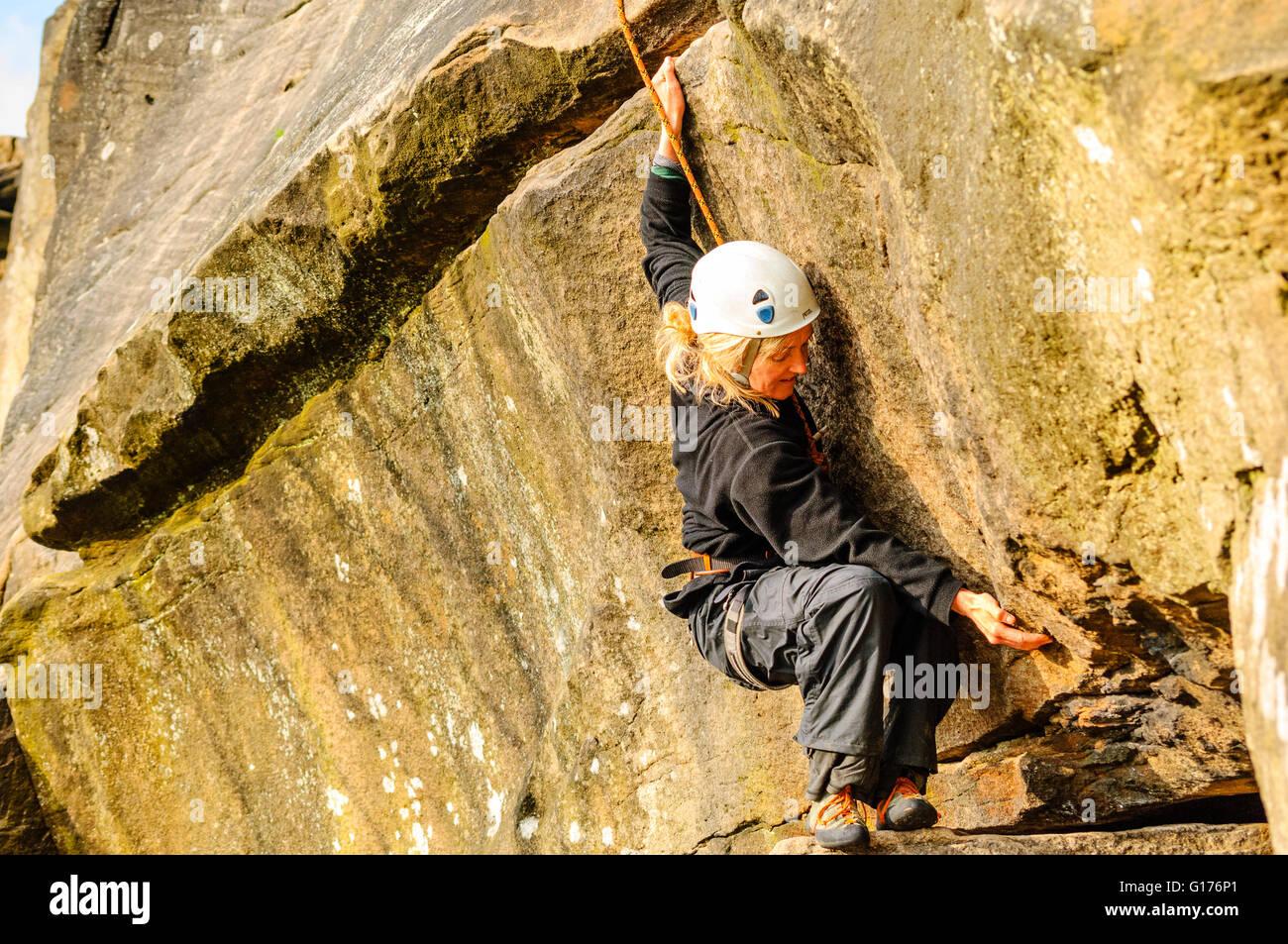 Climber on Tody's Wall, Froggatt Edge, Peak District - Stock Image
