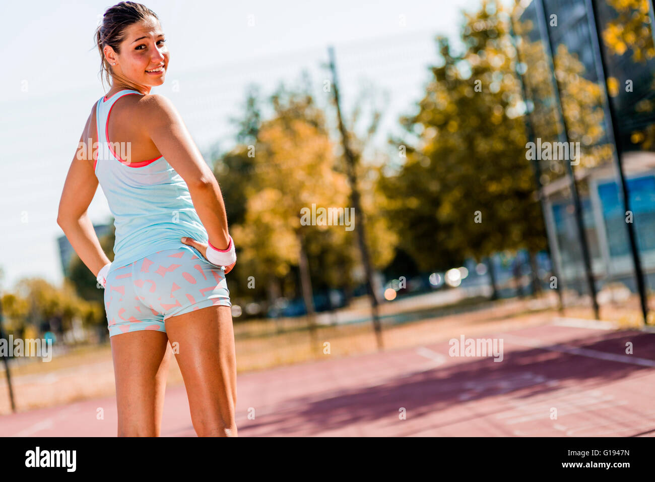 Beautiful young woman smiling during exerice - Stock Image