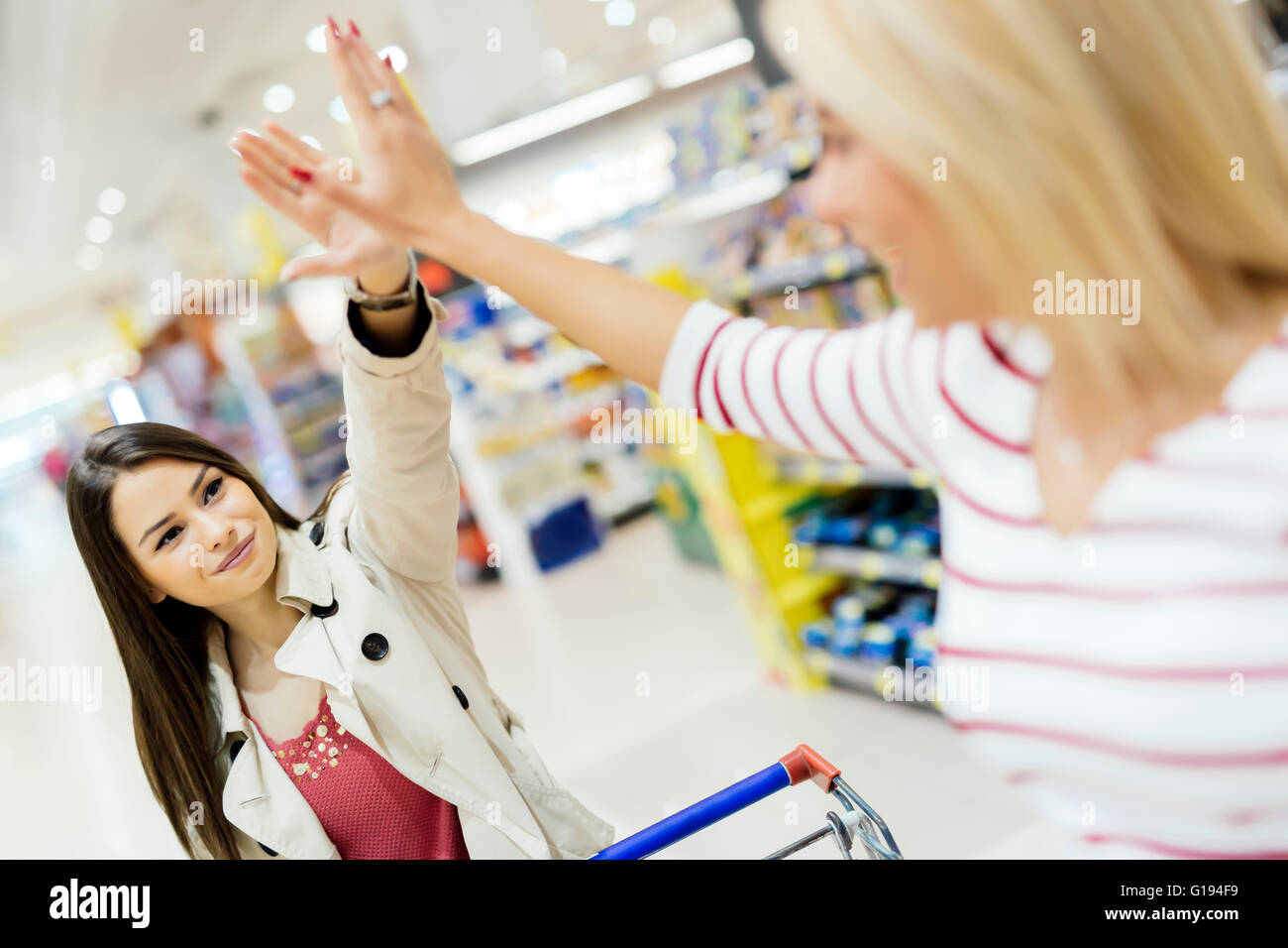 Women satisfied after shopping in supermarket - Stock Image