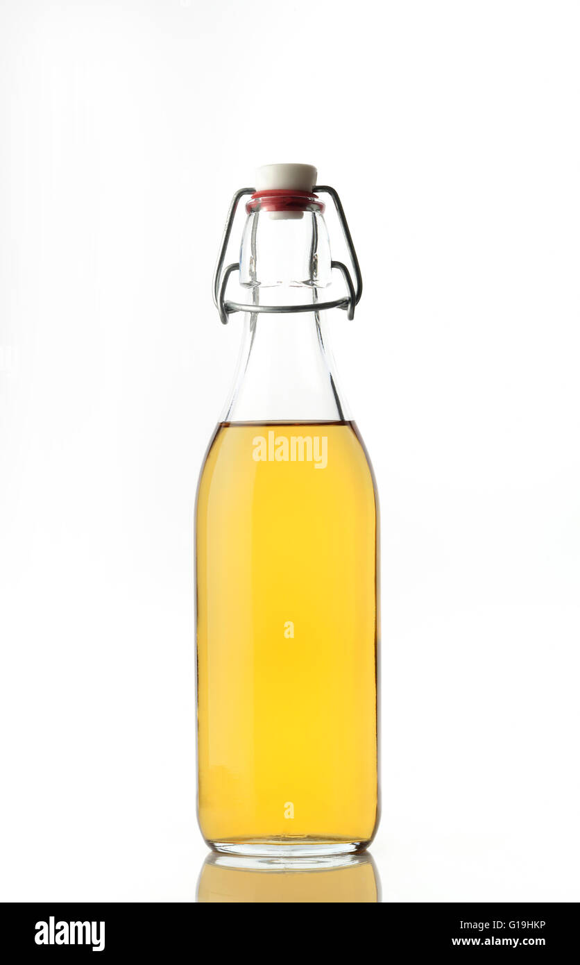 Apple Cider Vinegar in a Glass Bottle with Stopper Stock Photo