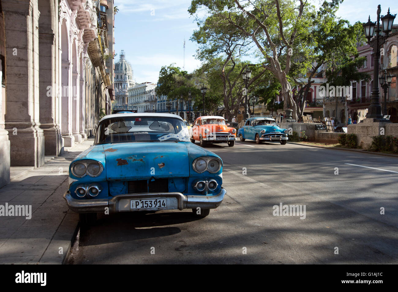 Classic 1950\'s American cars driving on a wide street in Centro ...