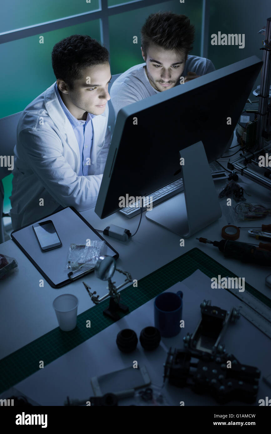 Engineering students in the laboratory, they are working with a computer, innovation and technology concept - Stock Image