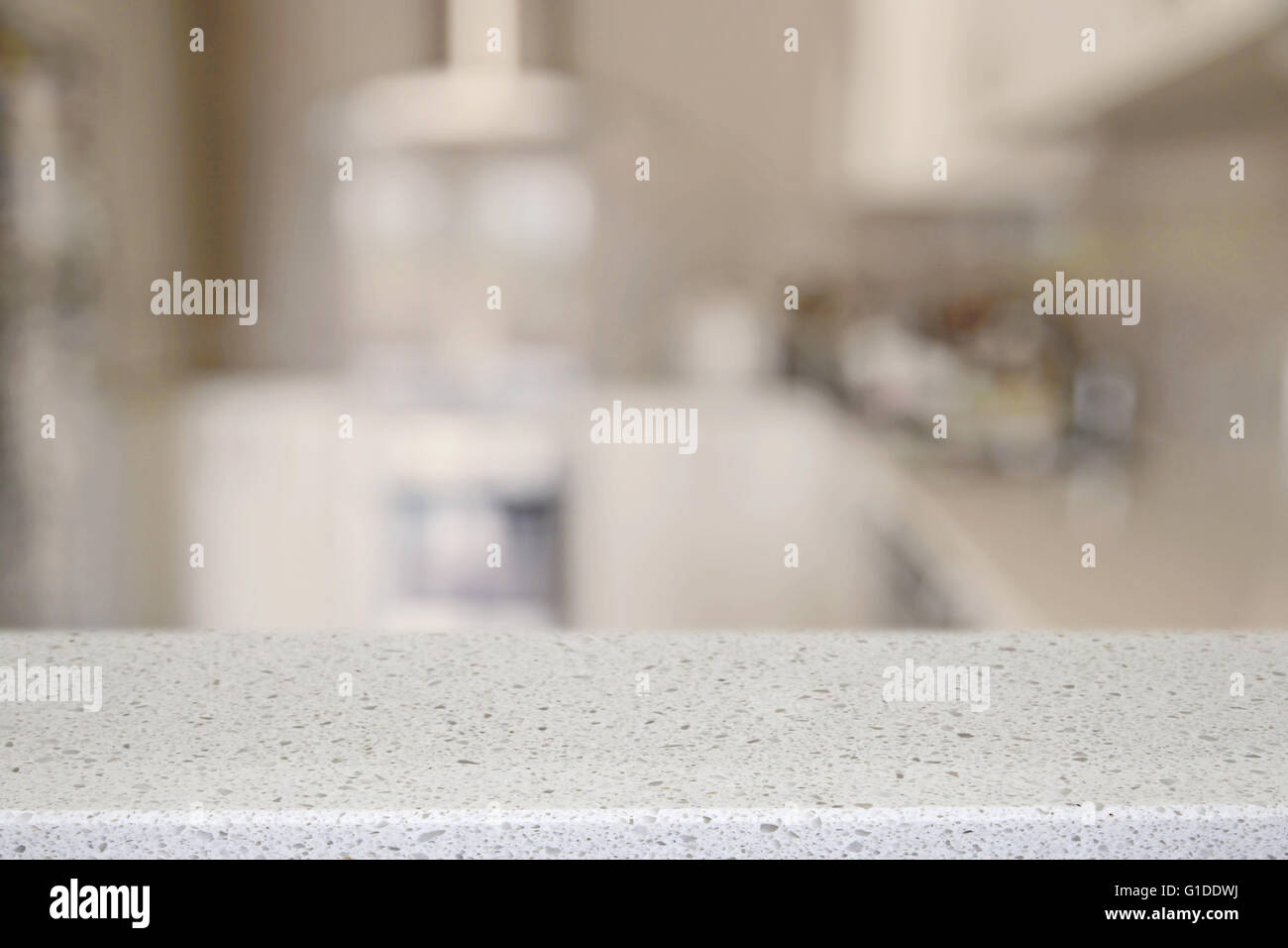 White Quartz Stone Counter Top With Blur Kitchen Background Product