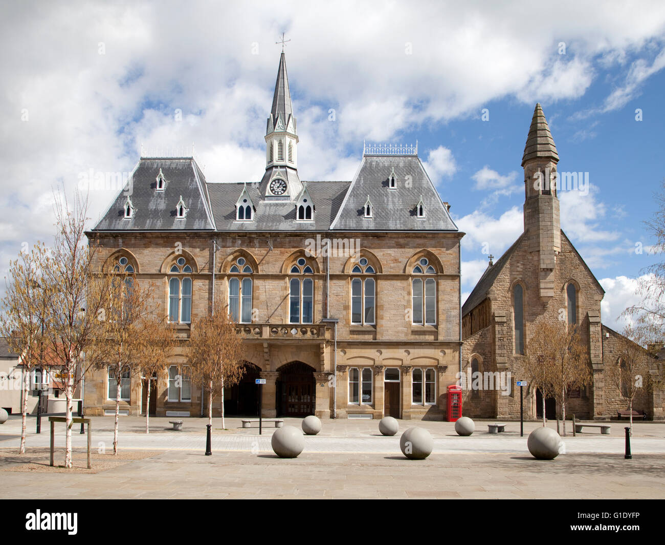 The Town Hall in Bishop Auckland , a Gothic style Victorian Building overlooking the market place at the centre Stock Photo