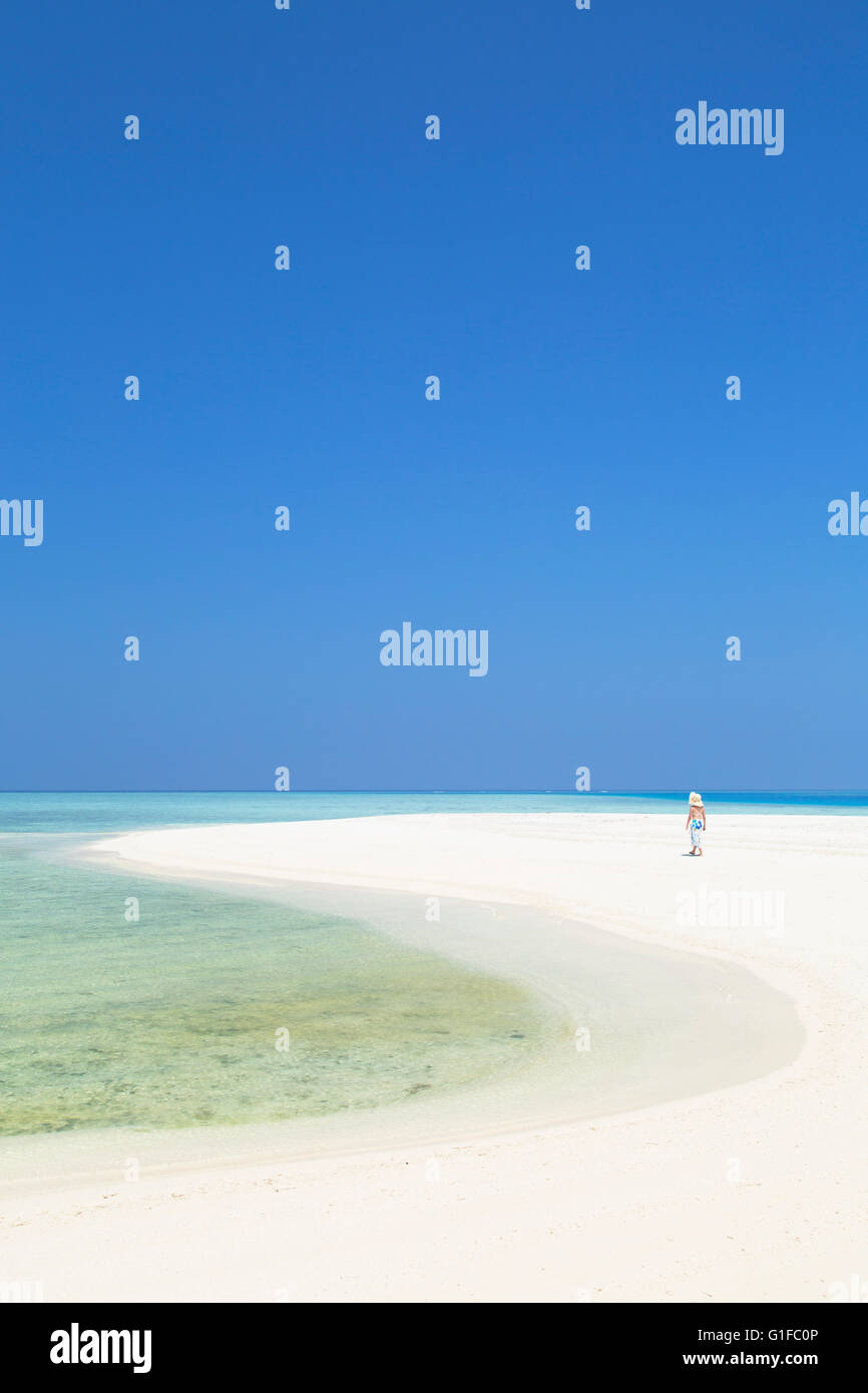 Woman on sandbank, Kaafu Atoll, Maldives - Stock Image