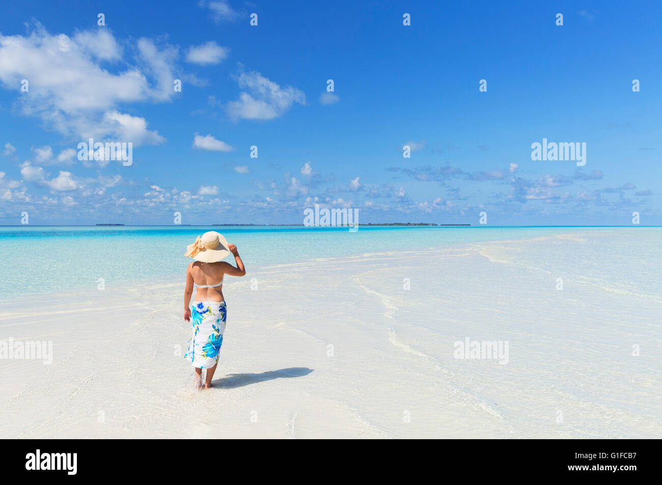 Woman on tropical island, South Male Atoll, Kaafu Atoll, Maldives - Stock Image