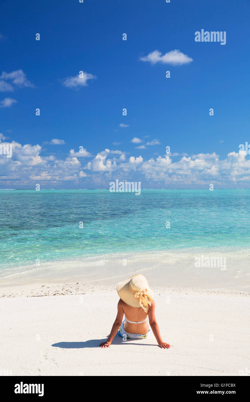 Woman on sandbank, South Male Atoll, Kaafu Atoll, Maldives - Stock Image