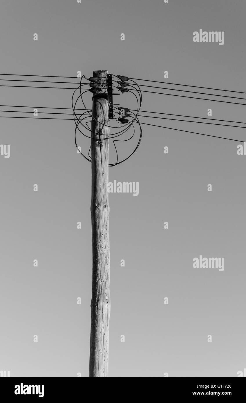lateral view of an old-fashioned electric pole with cables and wires ...