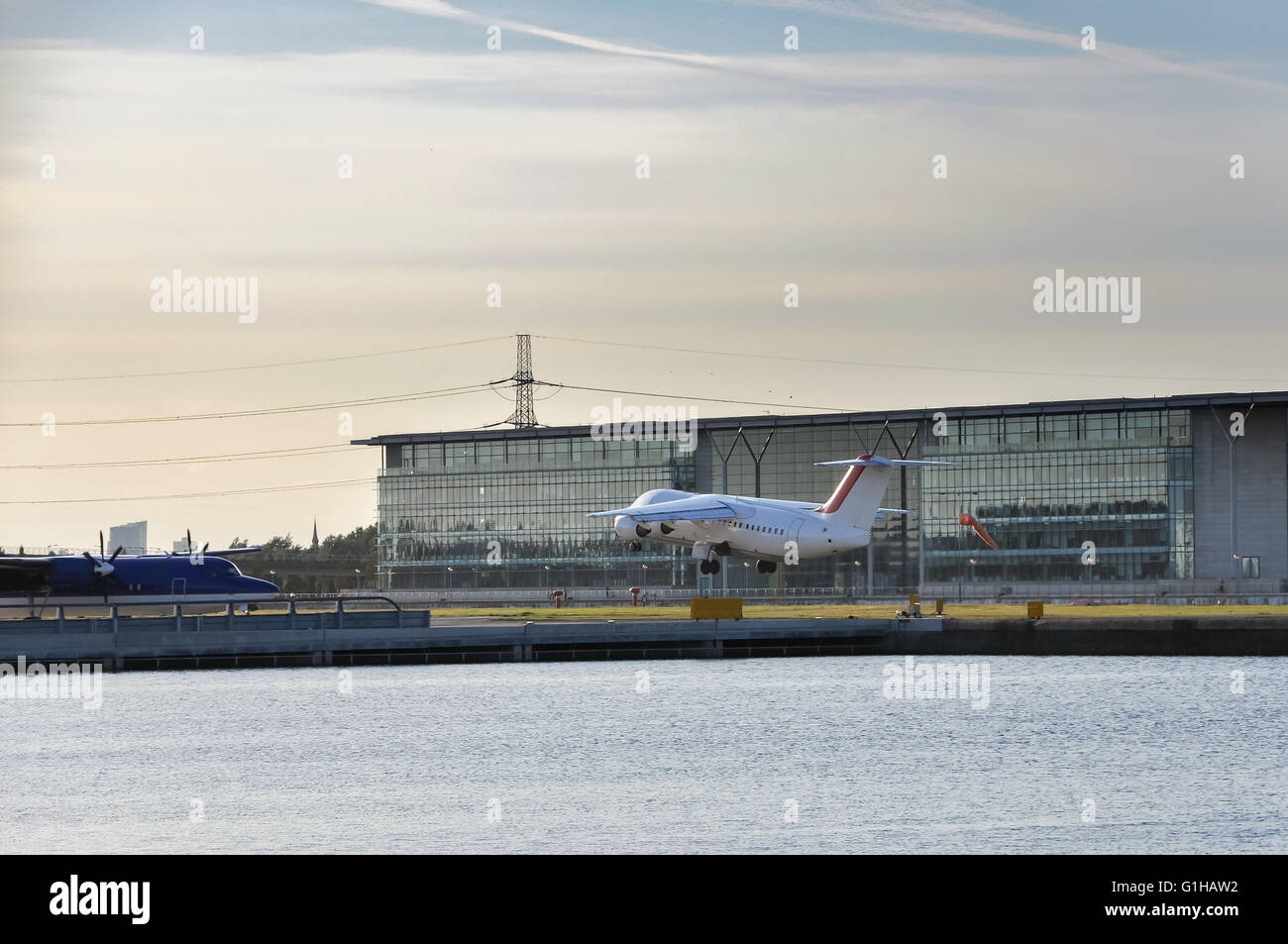 View of an airplane taking off from the London City Airport, UK Stock Photo