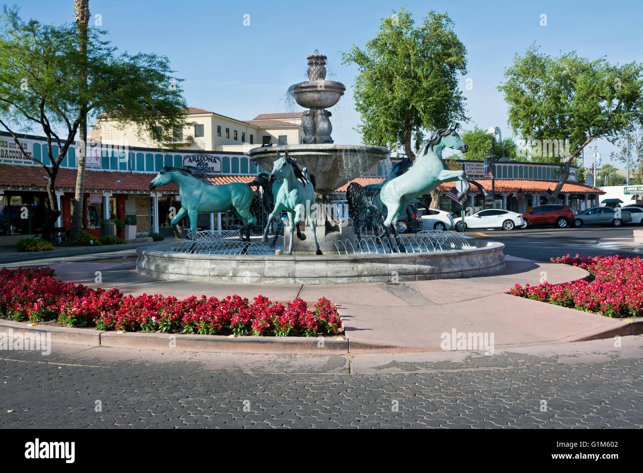 Water fountain with statues of Arabian horses in the 5th Avenue shopping area of Scottsdale, Arizona.  Created by Stock Photo