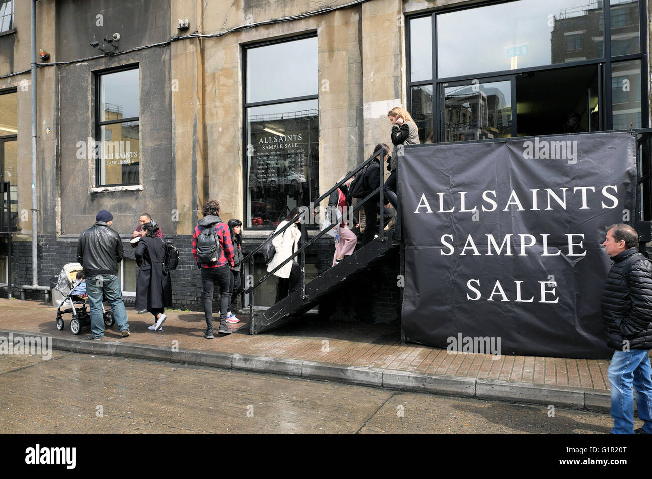 People shopping at allsaints sample sale in shoreditch warehouse.