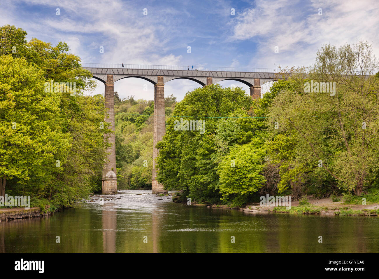 Pontcysyllte Aqueduct, built by Thomas Telford, and a World Heritage Site, reflecting in the River Dee, with people Stock Photo
