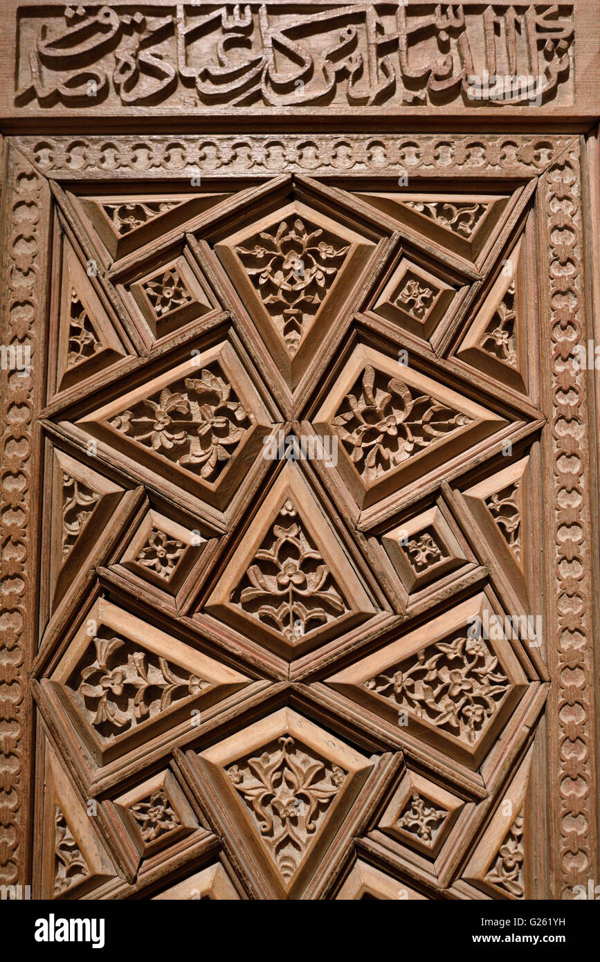 Carved wood door of a Mausoleum from 15th Century Mazanderan Iran - Stock Image