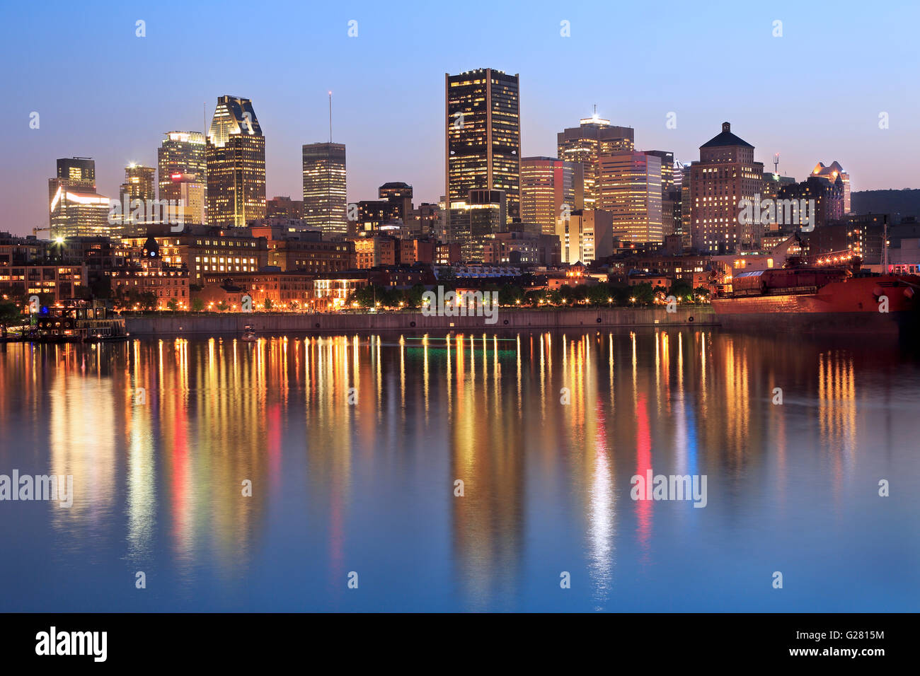 Montreal skyline at dusk and St Lawrence River, Quebec, Canada - Stock Image
