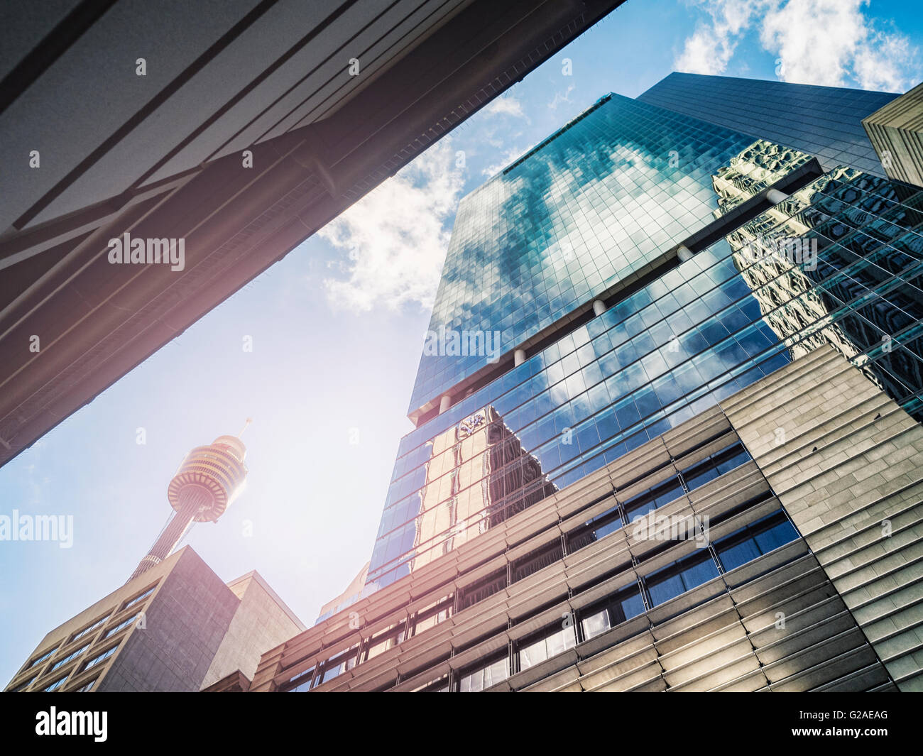 Clouds reflecting in glass buildings - Stock Image