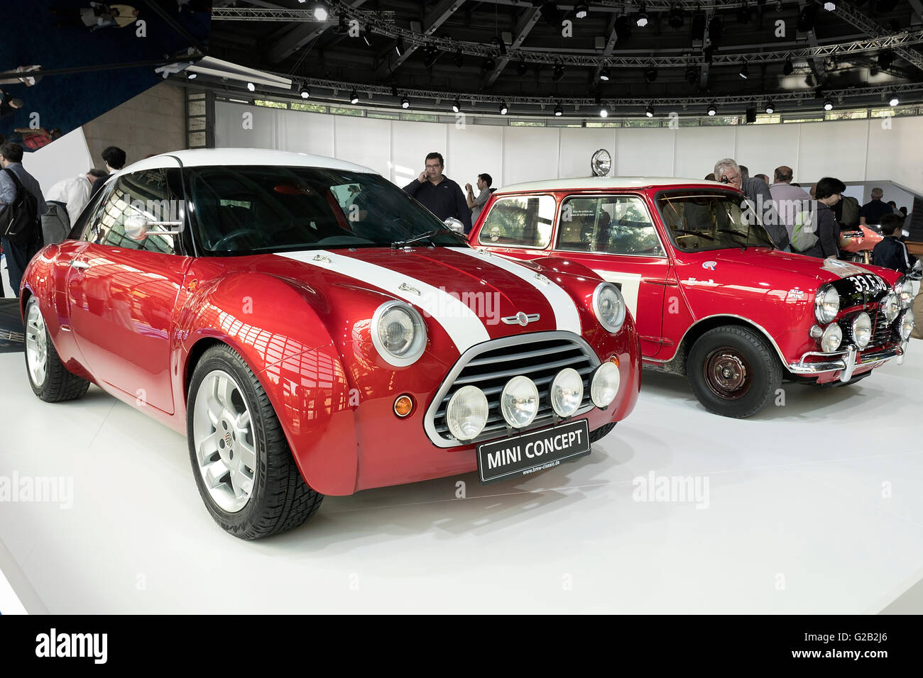 Mini Cooper recreation on display with an original BMC Mini Cooper at Villa Erbe concours Como Italy. - Stock Image