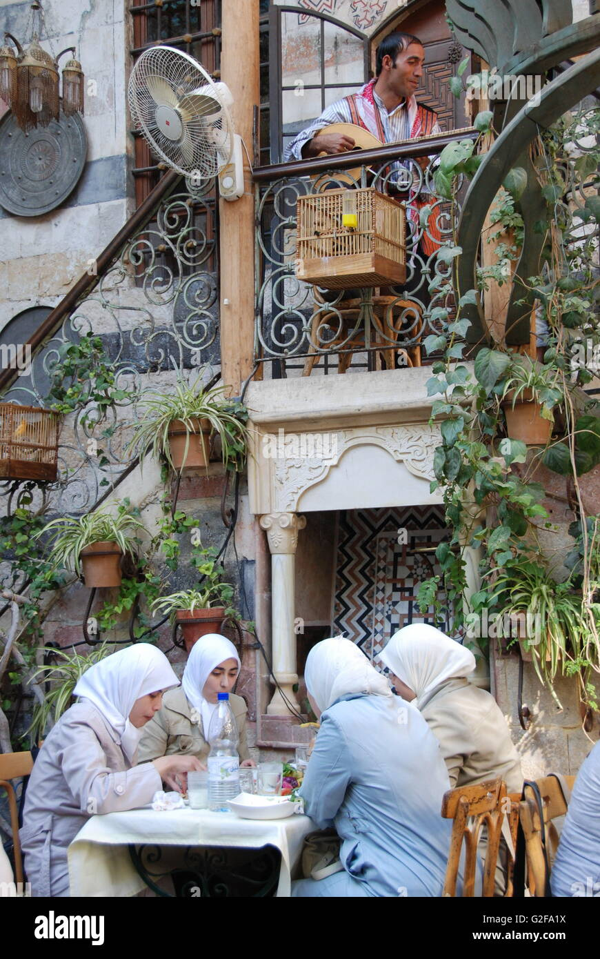 Damascus - Beit Jabri Restaurant, Four Ladies In Hijab Having Lunch - Stock Image