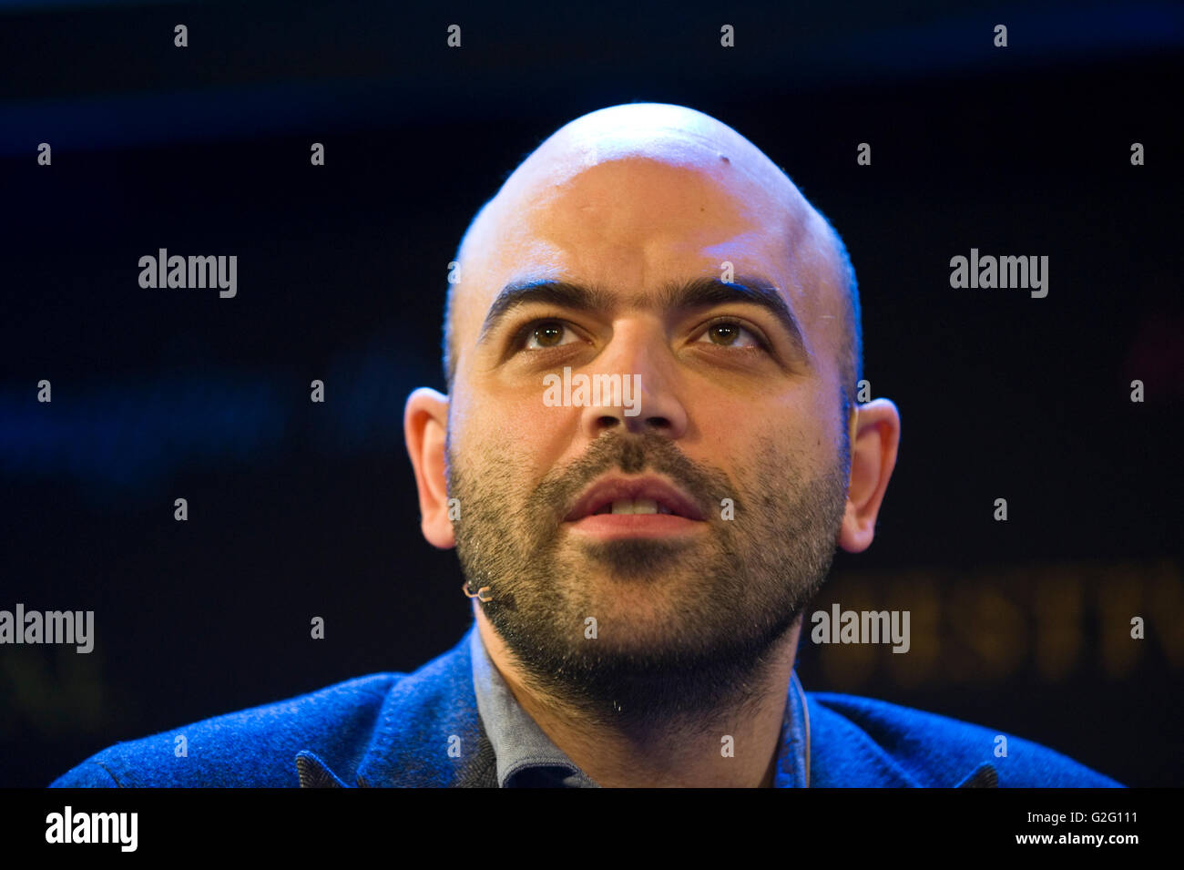 Roberto Saviano investigative journalist & author who exposed organized crime in Italy speaking on stage at - Stock Image