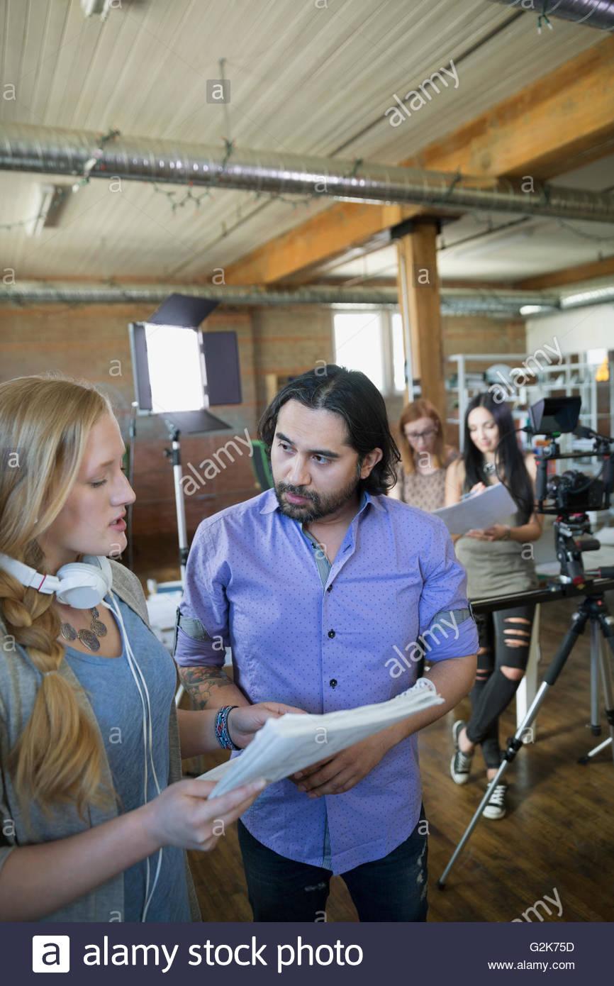 Creative business people preparing to film tutorial - Stock Image