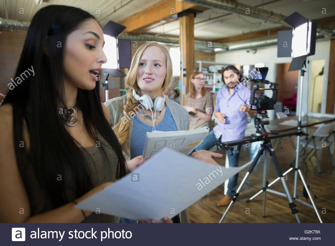 Creative businesswoman preparing to film tutorial - Stock Image