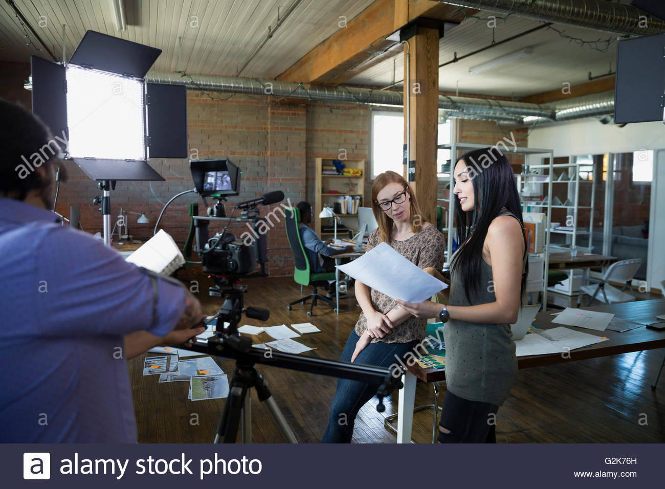Creative business people preparing to film video tutorial - Stock Image