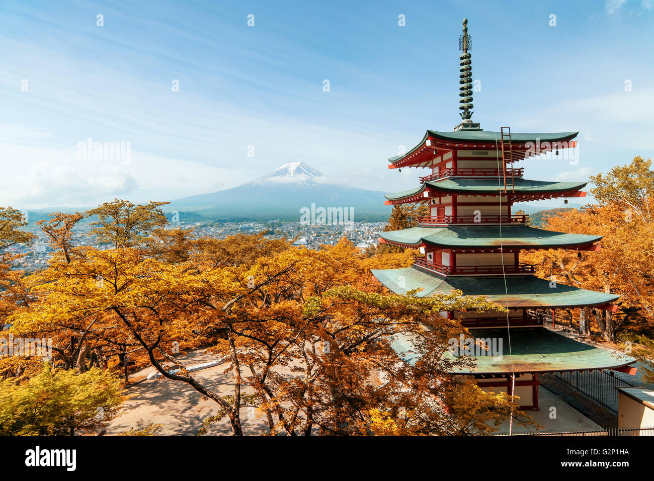 Travel in Japan - Beuatiful autumn in Japan at Red pagoda with Mt. Fuji in background, Japan. - Stock Image