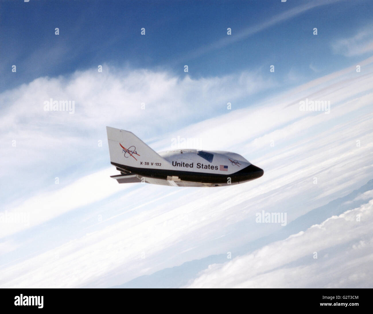 The NASA X-38 prototype Crew Return Vehicle descends during a test flight at the Dryden Flight Research Center July - Stock Image